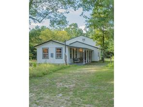 Texas down home style.  Relax on the porch and enjoy the quiet and privacy on this beautiful 9.82 acre piece of Texas paradise.