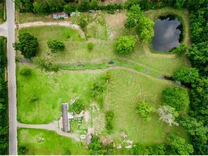 Road access to lot. Also, this aerial shot shows adjoining property not included in sale.