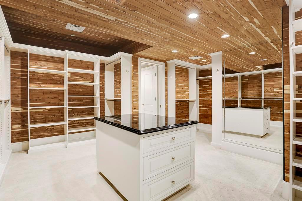 Yes, it just keeps getting better.  Look at this cedar covered custom closet.  Note the amount of hanging and storage space.