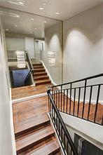 Private staircase leads to the second floor.  Hardwood treads all the way up.