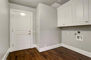 Second floor utility room has extra storage.