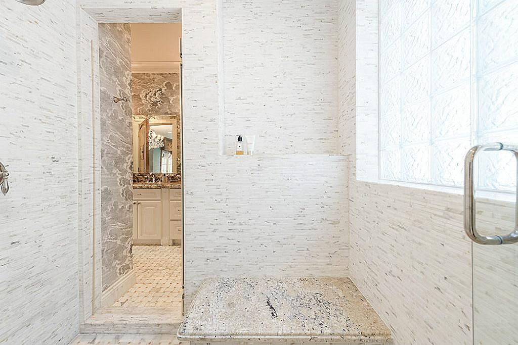 [Double-Entry Shower]The two master bathrooms connect through the oversized, marble-clad, double-entry shower.