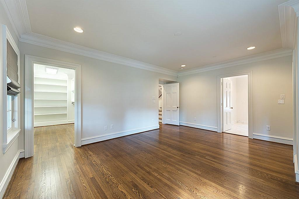 [Bedroom 17x13]Large, airy secondary bedroom offers a custom-fitted walk-in closet and en suite bathroom.