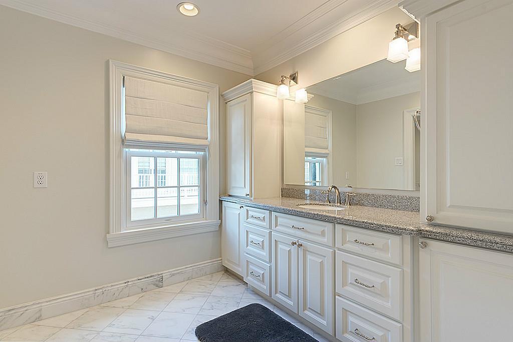 [En Suite Bathroom]Lavishly appointed with granite sink deck. marble-tiled floor.