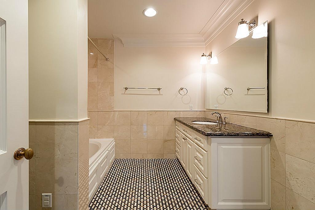 [En Suite Bathroom]Note basket-weave patterned marble-tiled floor, granite sink deck.