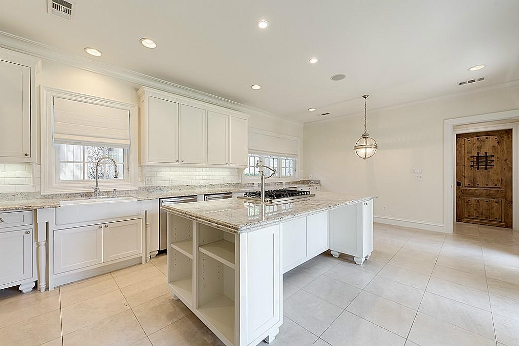 [Kitchen (15x13]Professional-grade appliances, including a SubZero refrigerator/freezer and Viking range and ovens, distinguish the light-filed gathering kitchen and breakfast area.
