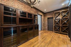 [Wine Room (16x9]Originally the sun room, the wine room offers brick walls, tall windows and elevator access.