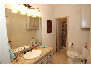 Bathroom  adjoins both bedrooms for easy entry.