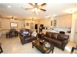 Living area  adjoining dining room and kitchen is completed with crown molding