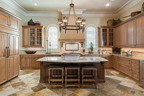 Kitchen (20x13) - The kitchen has Brookstone maple cabinetry, ogee-edged, Calacatta Gold marble and beveled Kashmere Gold granite surfaces; a quartzite floor; and professional grade appliances.