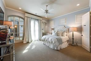 Fourth Bedroom (15x15) - The large, light-filled fourth bedroom has French doors accessing stone tile balcony.