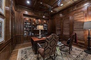 Study (16x14) - Flanking the foyer, an impressive study features a hand-scraped alder floor, alder paneling, and floor-to-ceiling arched bookcases.