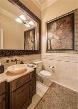 Powder Room- Located off of the study, the powder bath has an onyx vessel sink and countertop.