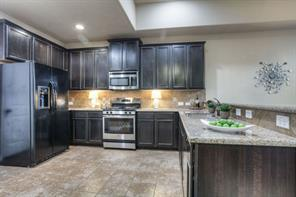 Gorgeous kitchen with granite counters and stainless appliances