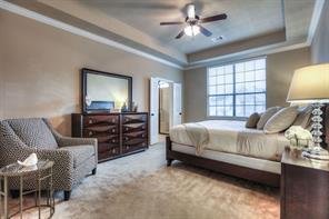 Spacious master bedroom with room for large furniture and sitting area