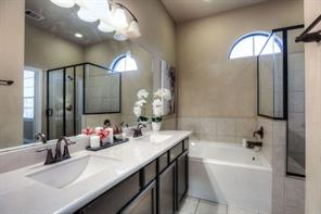 Stylish double sinks and tub for soaking and relaxing