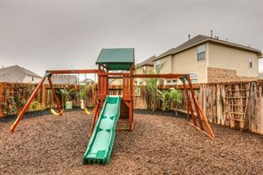 Great backyard with play equipment included