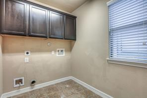 utility room for washer and dryer is located upstairs next to the loft area