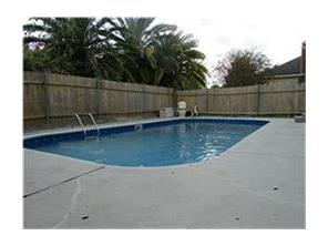 Pool with large freshly painted concrete patio