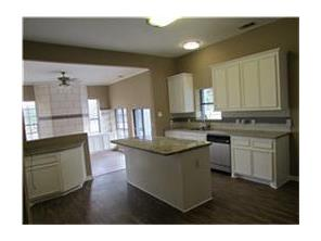 Spacious kitchen with granite counter tops and island
