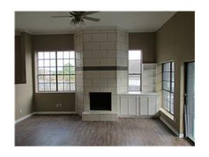 Living Room with tile fireplace