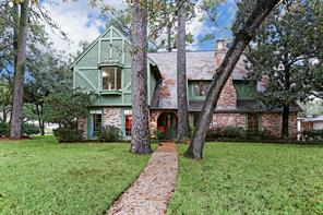 Beautiful home with large trees on corner lot.