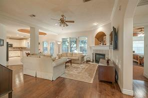 Family room offers spacious flow of entertaining space filled with architectural charm.