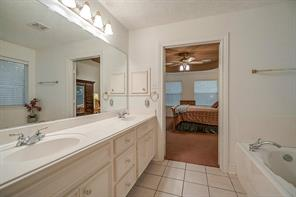 The master bathroom has dual sinks, lots of storage space and a soaker tub.