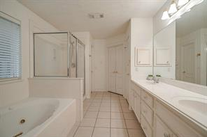 This is another view of the master bathroom, showing the walk-in closet and walk-in shower.