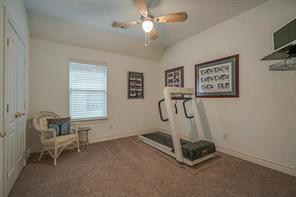 Another secondary bedroom that is currently being used as an private gym.