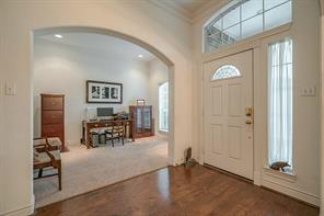 Open foyer with the study to the right of the entrance and the formal dining to the left.