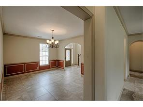 Grand entrance complete with mahogany and etched glass door, tile flooring high ceilings, crown molding and more greet your family and friends.