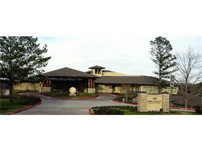 The country club offers two dining areas, pools, fitness center and golf shop