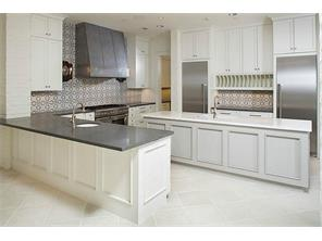 Island kitchen in a recent construction by Cupic Custom Homes - selections for Landon Ln are still available to be made.