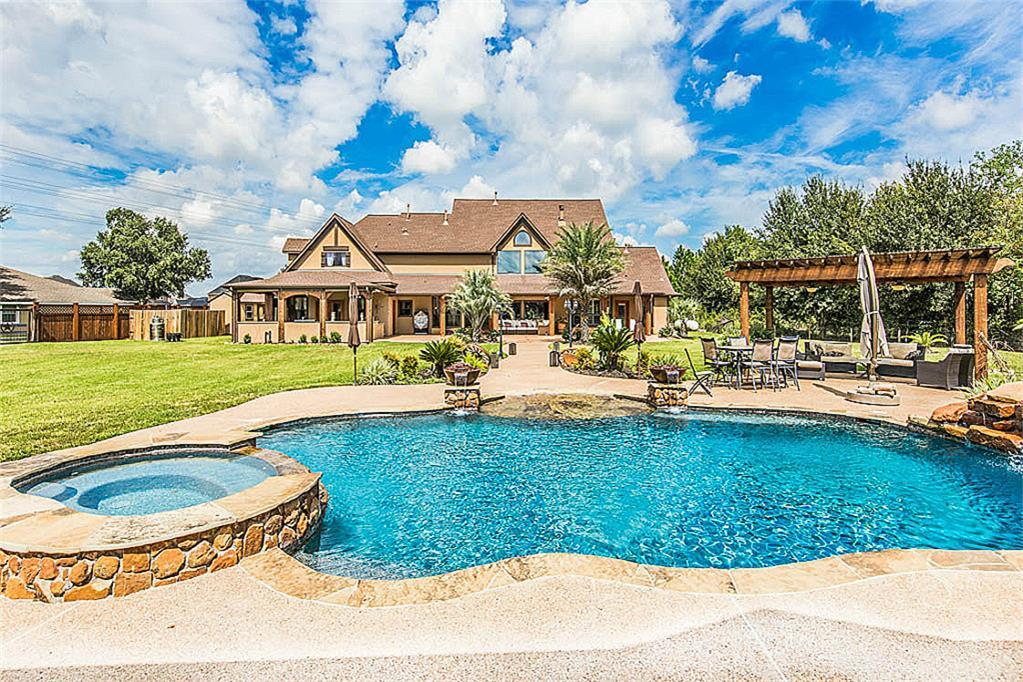 BREATHTAKING Custom Home on 1.633 Acres that is Truly A One-of-A-Kind Piece Property in Katy! 27 Ft High Cathedral Ceiling in the Living Room w/A Gorgeous view of the Stunning Backyard. The Master Closet is an Absolute & AMAZING Must See! Beautiful Pool & Hot Tub,2/1 Guest House, Outdoor Kitchen,Fire Pits,Surround Sound,Commercial Grade Security Camera System, Electronic Gates, Lights along the back of the property,220 Voltage x3 in Backyard, No HOA, No Water Bill 2.08% Tax Rate UNRESTRICTED, Please Come see this one in a lifetime opportunity to own land and have your own business all in one place!  There is nothing else like this in Katy South of I-10 zoned to Tompkins High School! The Home has NEVER FLOODED