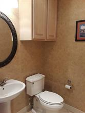 Lovely powder room with pedestal sink.
