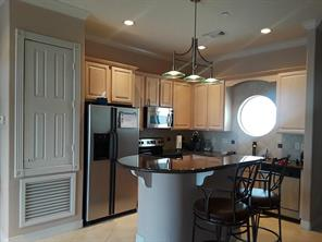 Kitchen offers granite counter tops, maple cabinets and stainless appliances.