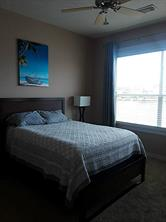 Master bedroom is located on the lake side of the condo. Great view!