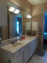 Double vanity master bath with a large walk in shower.