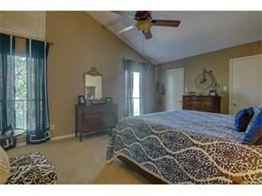 Spacious master bedroom with high ceilings and plenty of closet space