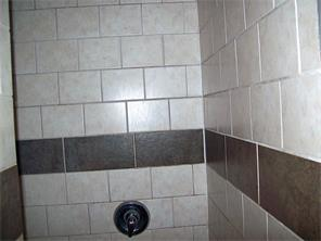 Master bath has a walk-in tile shower