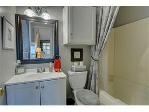 Guest bath with updated hardware and plumbing fixtures