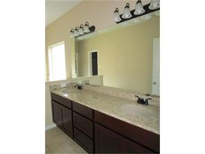 This is new with granite! A second sink and light was added so you have a rare master bath with 2 sinks