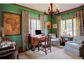 Inviting study with wallpaper, 3 windows, built-in bookshelves on side wall.  Pretty views of the outdoors.