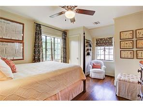 Seondary bedroom, light and bright, wallpapered with custom curtains and shade.