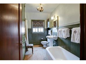 One of two secondary bathrooms.  Many original features make it charming for today s use!