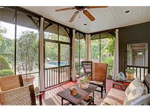 Rarely does a screened porch have this kind of charm.  Recent awnings and draperies, cement floor and doors to the pool.  Perfect for entertaining or cuddling up with a good book and a glass of wine.