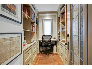Small office for work at home with lots of storage and stained glass door insert passed down in the family.