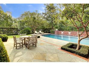Pool with grassy area to the far left and back, slate patio.