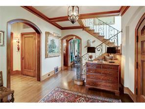 Charming entry with original stair banister, original hardwood floors and beautiful GumWood trim.